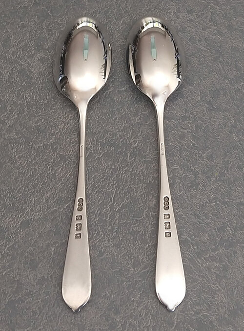 Back of antique English spoons restored after severe damage to spoon bowl