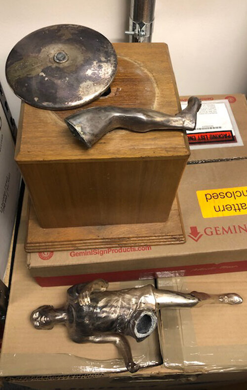 large athletic figure trophy broken in peices