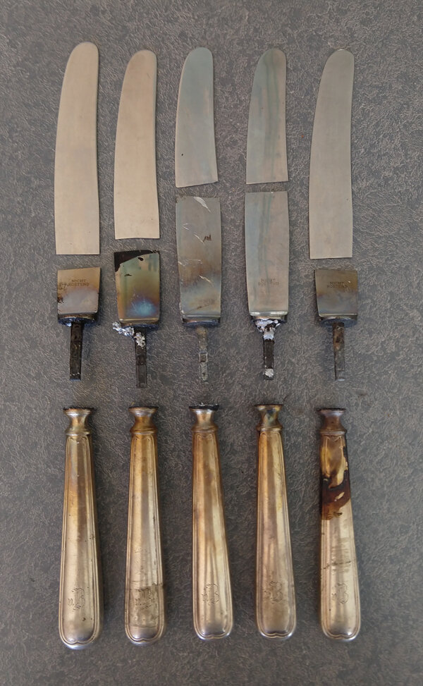 Broken steel knife blades removed from sterling silver handles