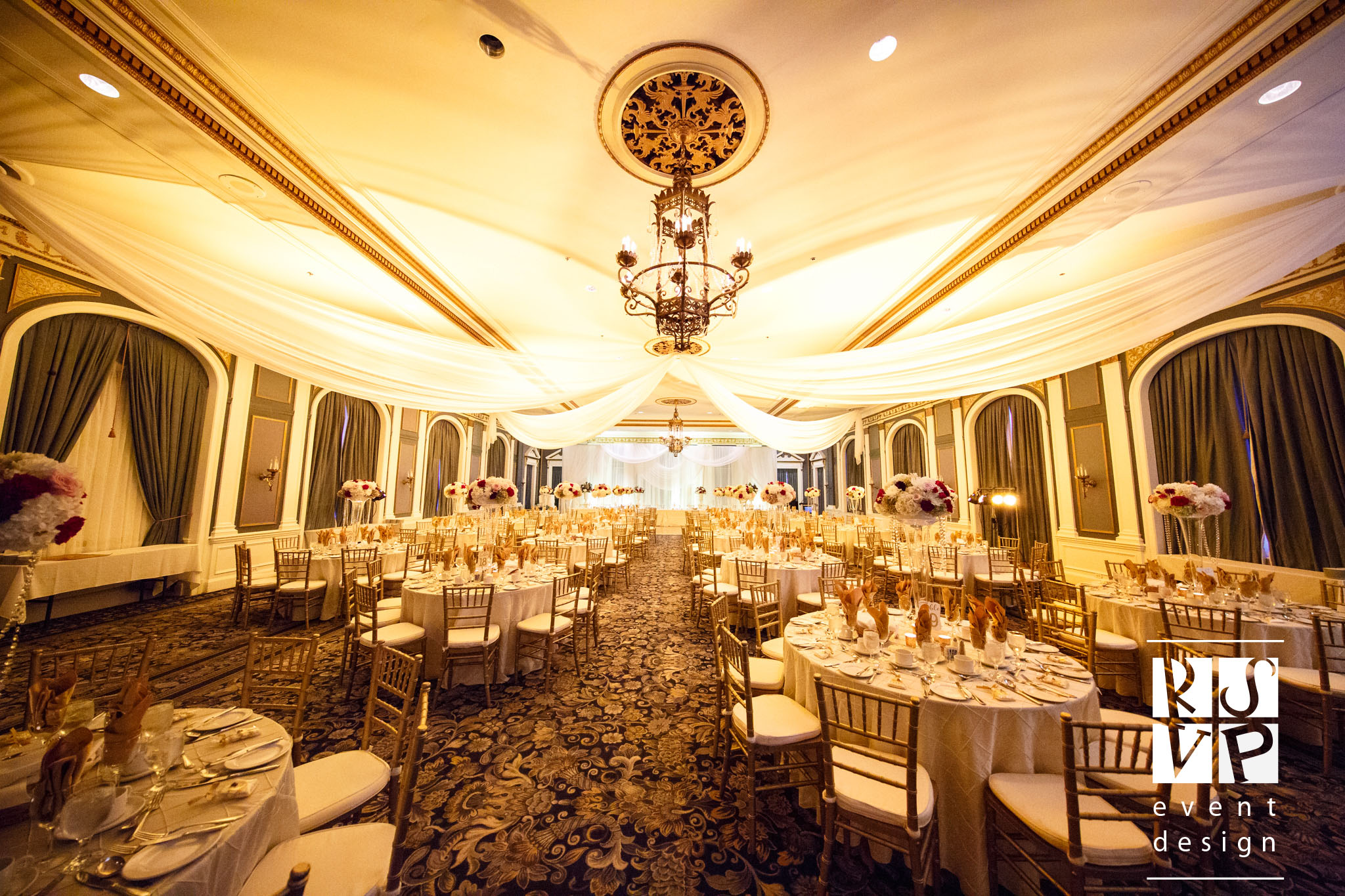 A classic and elegant Gold Wedding in Adam Ballroom was complete with warm lighting and stunning floral arrangements by Blossoms Living.  Photo: Chris Graham Photography
