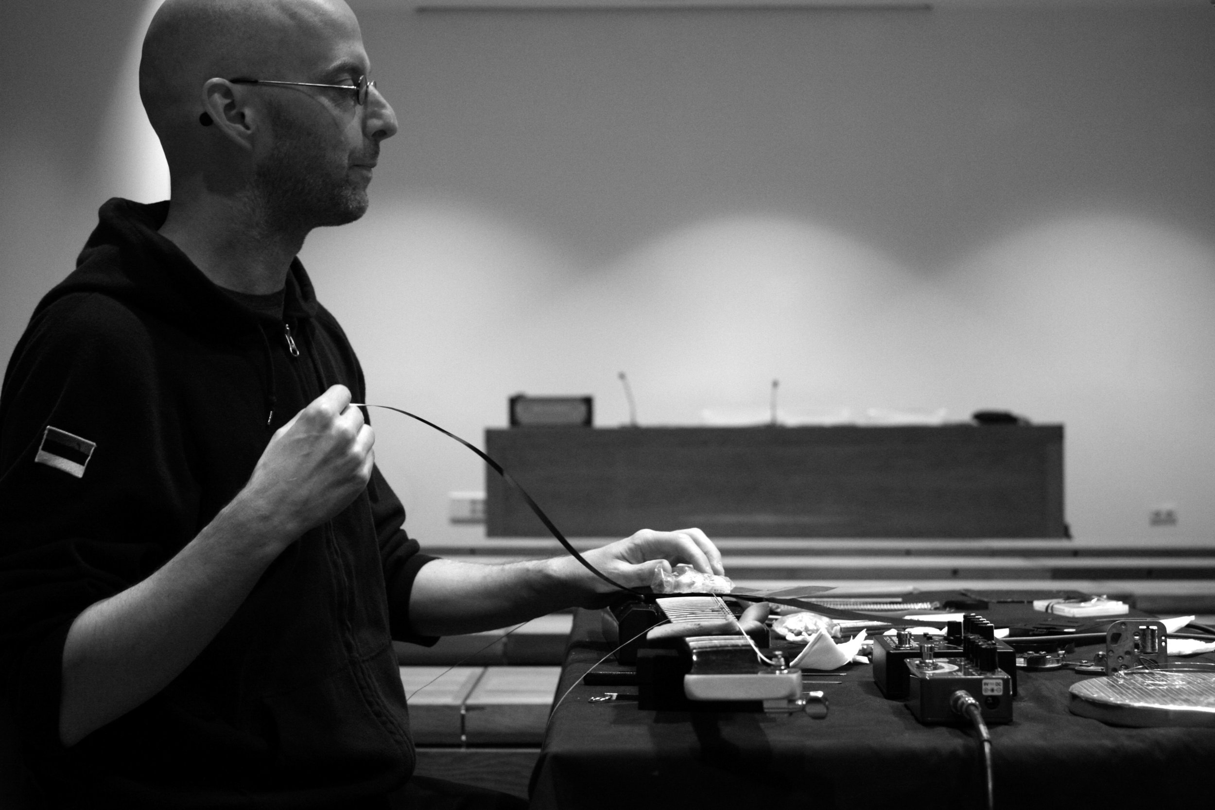 Tim Olive(Kobe JP) - The music of Tim Olive arises from collaboration with fellow musicians/sound artists, collaboration with physical and temporal setting, and collaboration with those involved in the act of listening. Using simple materials (including magnetic pickups, steel strings, tuning forks, metal strips, hand-wound motor mechanisms, magnetic tape, dental floss and analog electronics), Olive's work is predicated on the interplay of the human with material/time/space, and the uniqueness, intensity and unrepeatability that lives in each performing and/or recording situation.He is interested in music as a social activity, as a way of creating community, a way of countering the forces which lead to an increasing atomization of contemporary life; music as a felt experience rather than as a concept or a theory.A Canadian residing in Kobe, Japan, Olive has released music on Japanese, European and North American labels, with Jeff Allport, Cristian Alvear, Pascal Battus, Alfredo Costa Monteiro, Samuel Dunscombe, Nick Hoffman, Anne-F Jacques, Jin Sangtae, Jason Kahn, Takahiro Kawaguchi, Yukinori Kikuchi, Francisco Meirino, Katsura Mouri, Takuji Naka, Bunsho Nishikawa, Makoto Oshiro, Ben Owen, Horacio Pollard and Fritz Welch.Olive has performed/recorded in Asia, Australia, Europe and North America, with the recording collaborators listed above, as well as with Akiyama Tetuzi, Maria Chavez, Che Chen, Kelly Churko, crys cole, Joe Foster, Haco, Hong Chulki, Bonnie Jones, Nicola Hein, Richard Kamerman, Kostis Kilymis, Siew-Wai Kok, Madoka Kouno, Tomasz Krakowiak, Fangyi Liu, Cal Lyall, Toshimaru Nakamura, James Rushford, Carl Stone, Nate Wooley, Jared Xu and Yan Jun.In addition to organizing events in Japan, Olive runs the label 845 Audio.Listen: Tim Olive