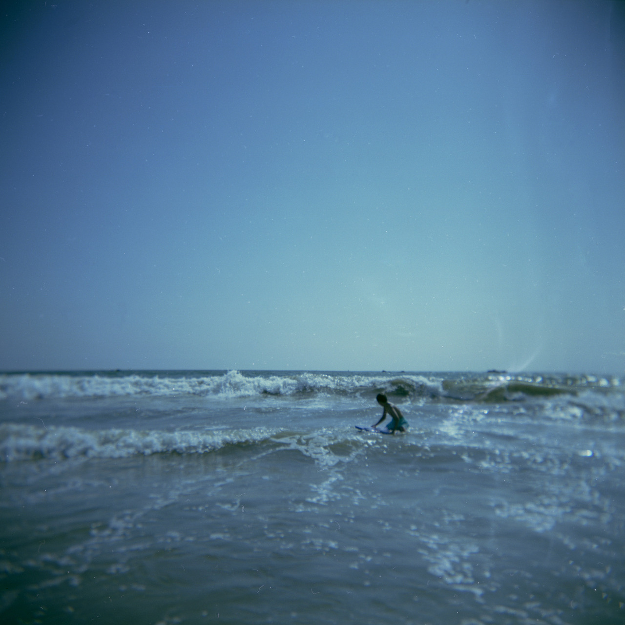 Xander surfing in Santa Monica.   August, 2012   Holga, Fuji Reala