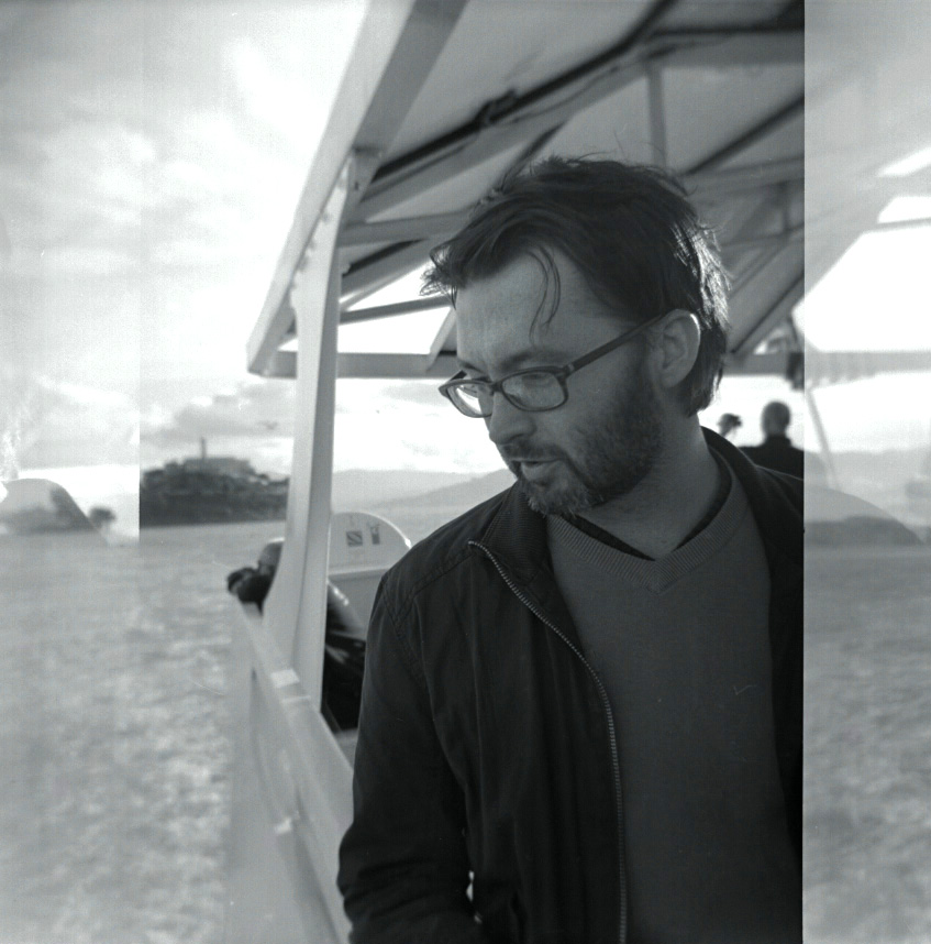 Mike Ambs on the ferry from Alcatraz. April, 2012   Holga, Tri X 400