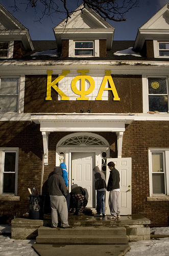 Ypsi Project : Kappa Phi Alpha (via  ericarhiannon )   Xander and I took a walk today while the sun was shining and warm. We passed these  Kappa Phi Alpha  members fixing the front door to the fraternity house.