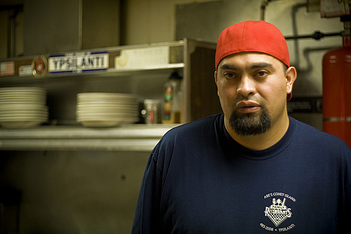 Ypsi Project : Ramiro   This is Ramiro. He is a cook at Abe's on Michigan Ave in Ypsilanti. I didn't sit down or order food when I went to Abe's, I walked in and wasted no time asking if I could take his picture. He agreed and went back to work! I snapped away for a few minutes before he finally turned around and looked at me:)