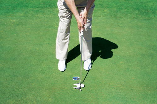 View hands, arms and shoulders while stroking a putt.