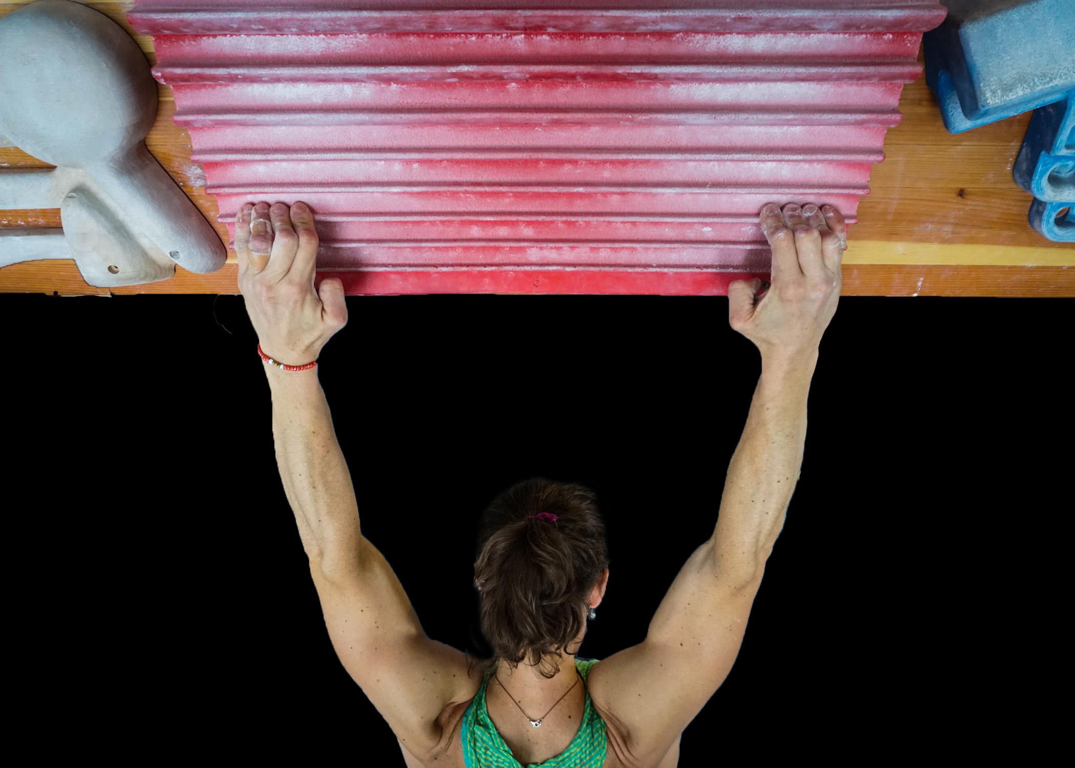 woman climber hangboarding strong women