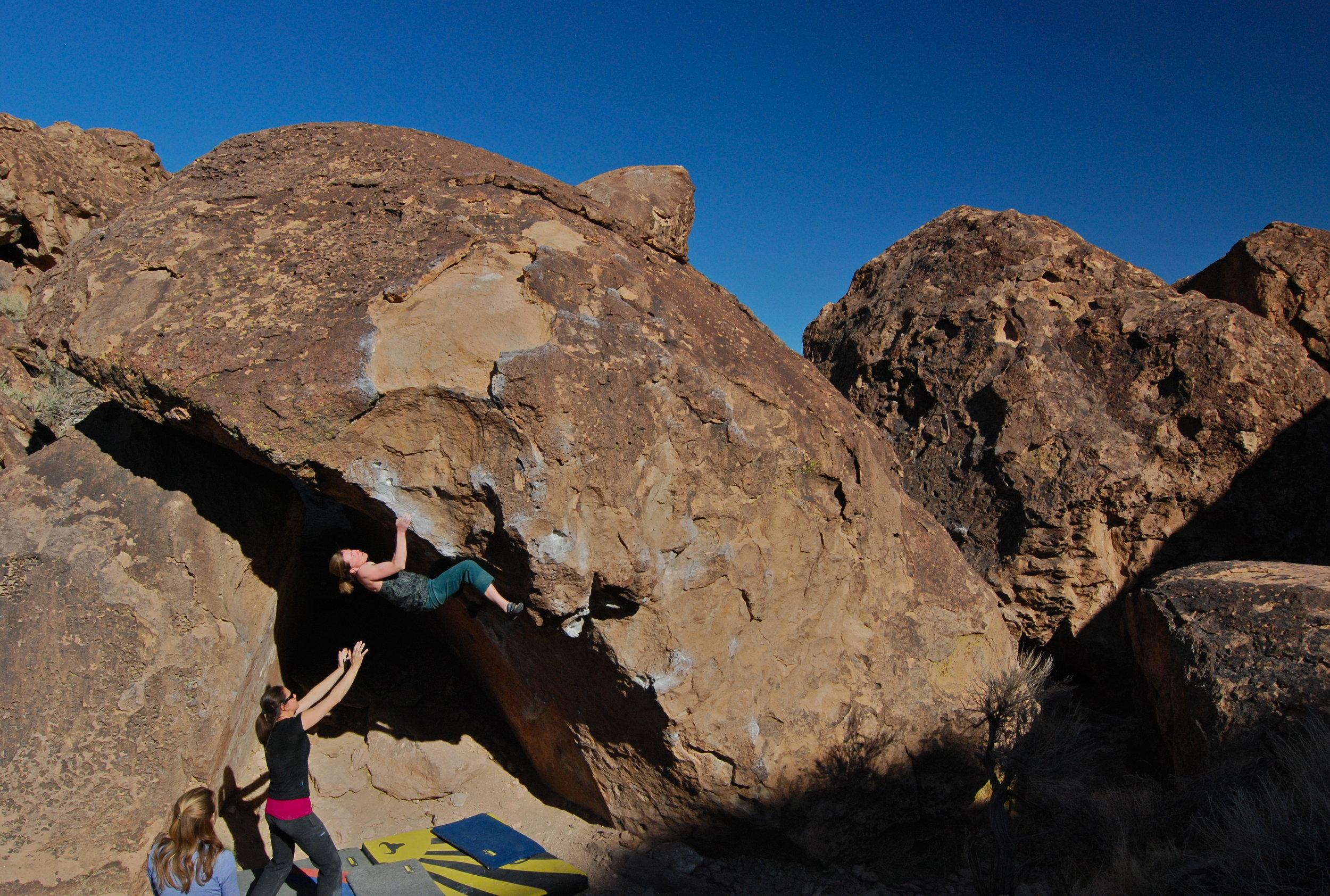 Sarah climbing The Gleaner, V6, in Bishop. Photo by Erik Cbristensen