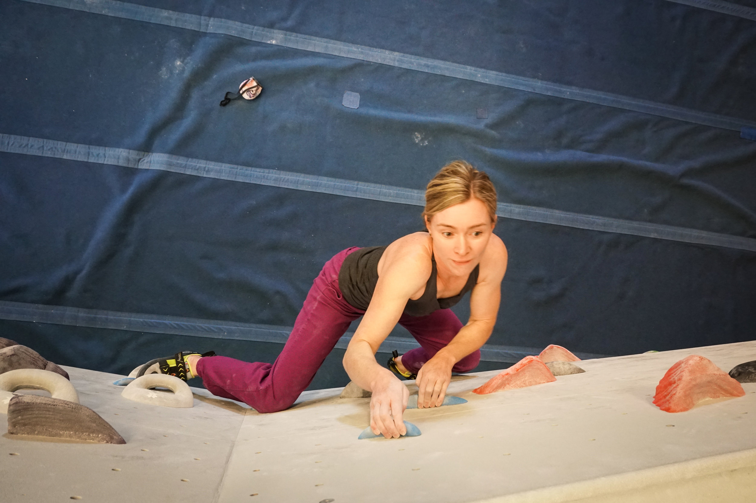 Climbing women strong bouldering