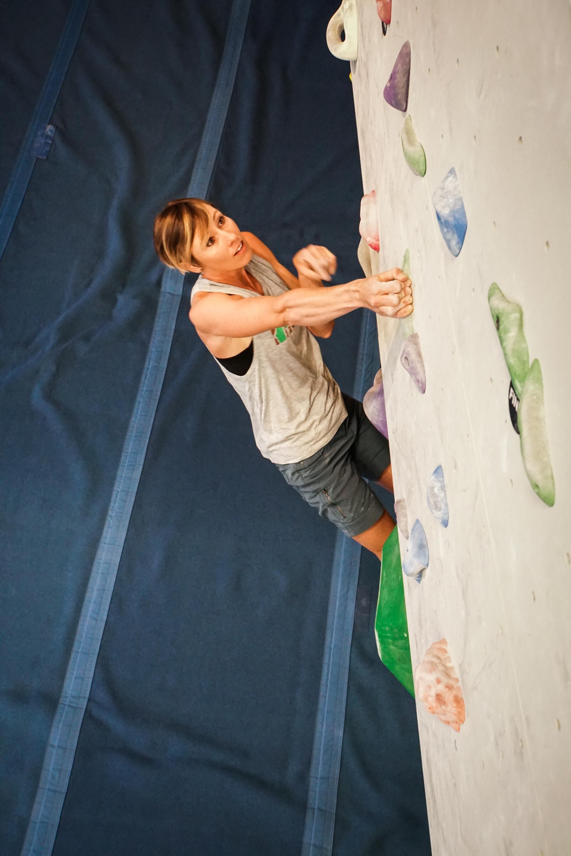 Heidi bouldering at the Spire Climbing Center.