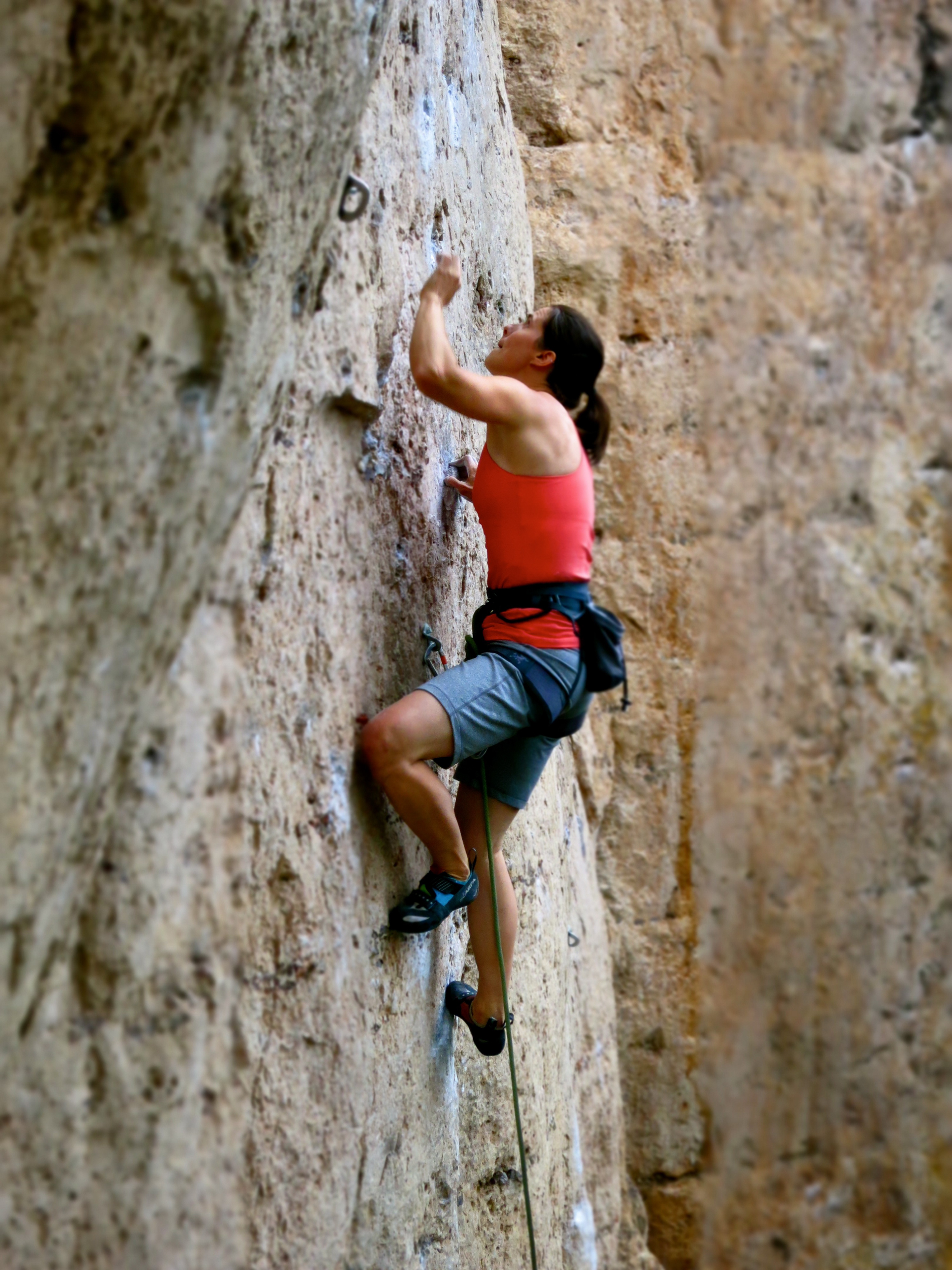 Leslie climbing in Ten Sleep.