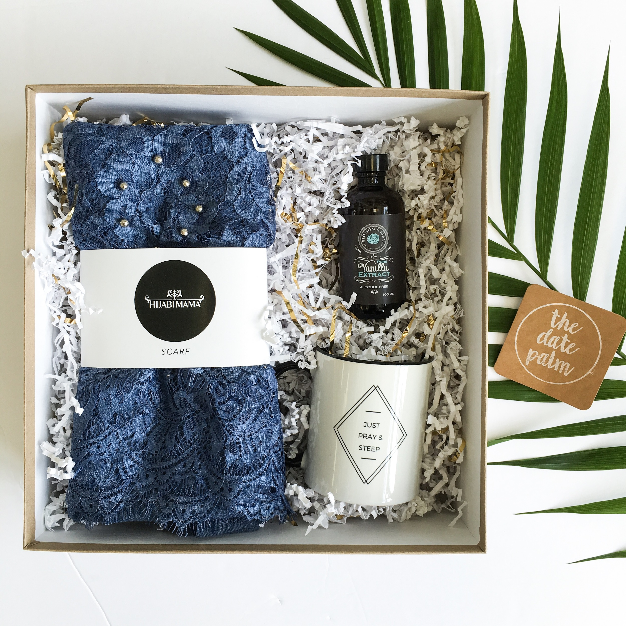 The DP Mother' Day Gift Box contains a Hijabimama lace trim hijab, a bottle of halal Vanilla Extract from Blossom & Bean and a Just Pray & Steep mug from Eastern Toybox. A complimentary Date Palm notecard is also included. Please feel free to email or call us ahead a time to order a gift box as inventory is limited. Hello@thedatepalm.com / 905-554-8000
