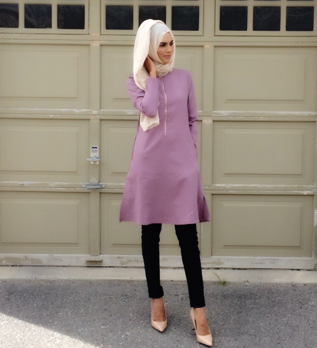 Effortless and comfortably stylish. This  mauve long tunic  ($45) falls just above the knee and looks & feels great with a comfy pair of leggings. A light and breathable viscose hijab in ivory ($15) with pearl trim is a wardrobe staple that can make the simplest ensemble look elegant. Zaheera has selected a pair of nude pumps to finish her look but a cozy pair of flats look great or knee high boots in the fall. Tunic & hijab by Hijabi Mama available at The Date Palm
