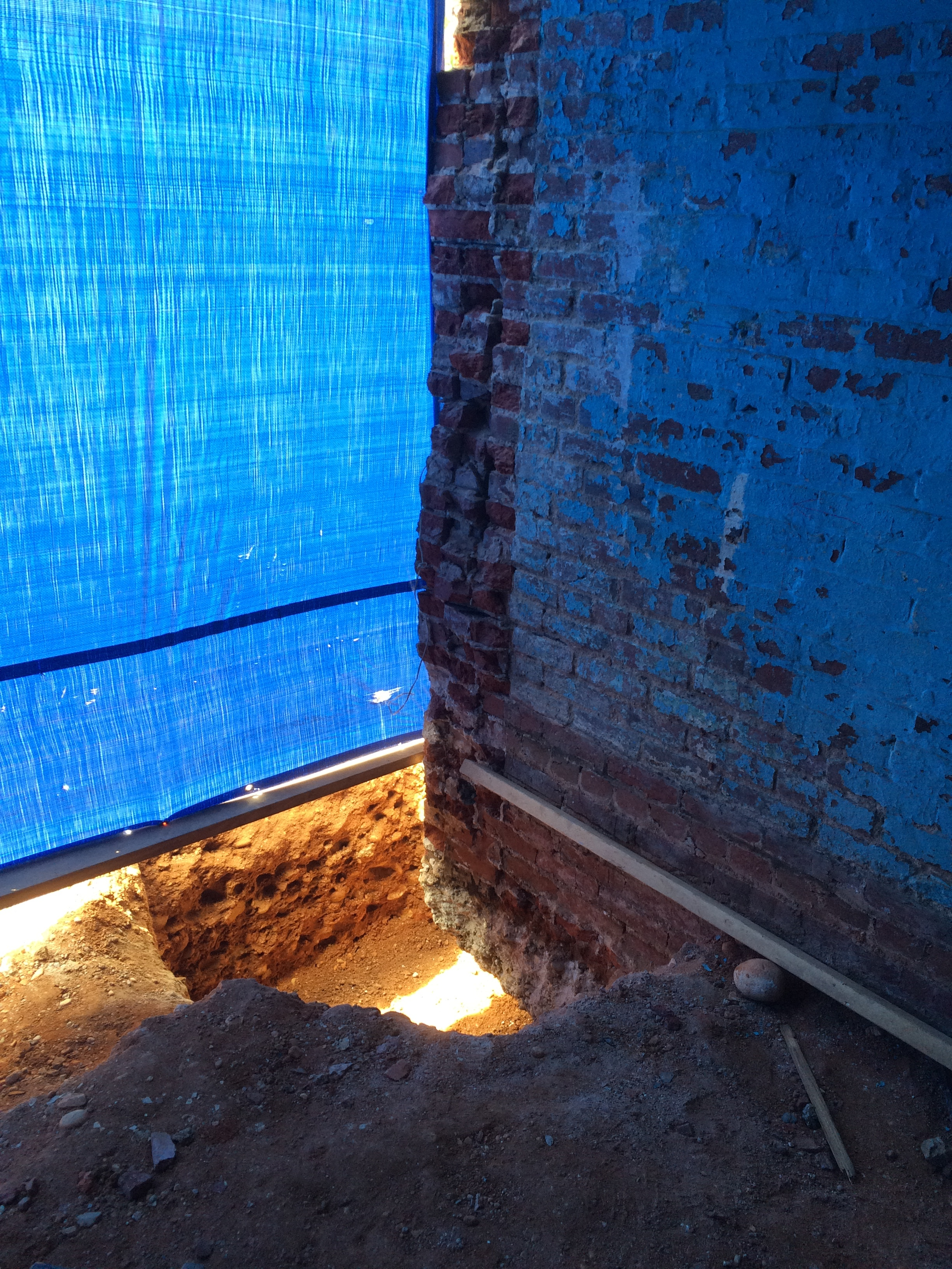 This photo shows the large pit dug at the rear corner of the original house which extends completely underneath the original foundation.