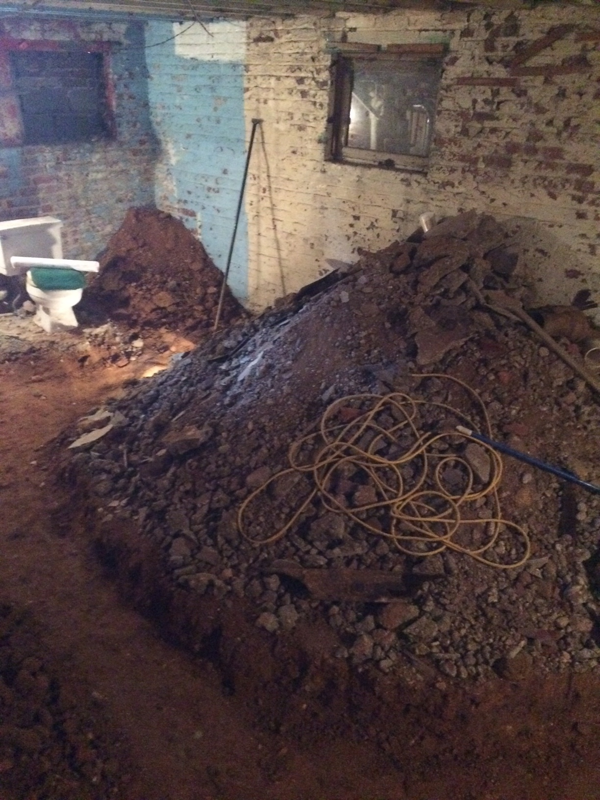 Soil and concrete had to be dug by hand and piled within the basement before being hauled away.