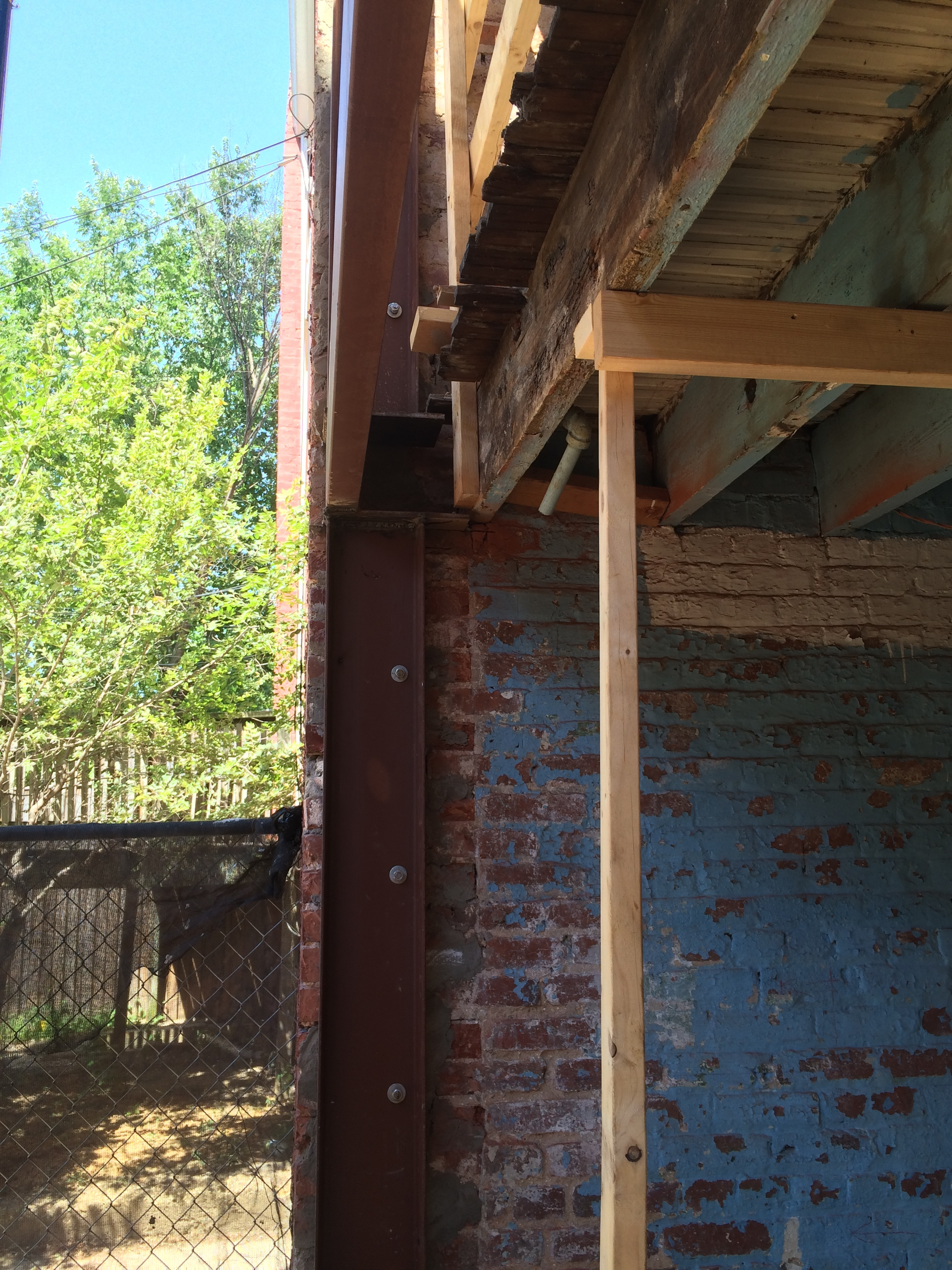 New steel frame installed at basement level. The bolts have been set into the old brick wall with epoxy to create a stronger bond with the old brick.