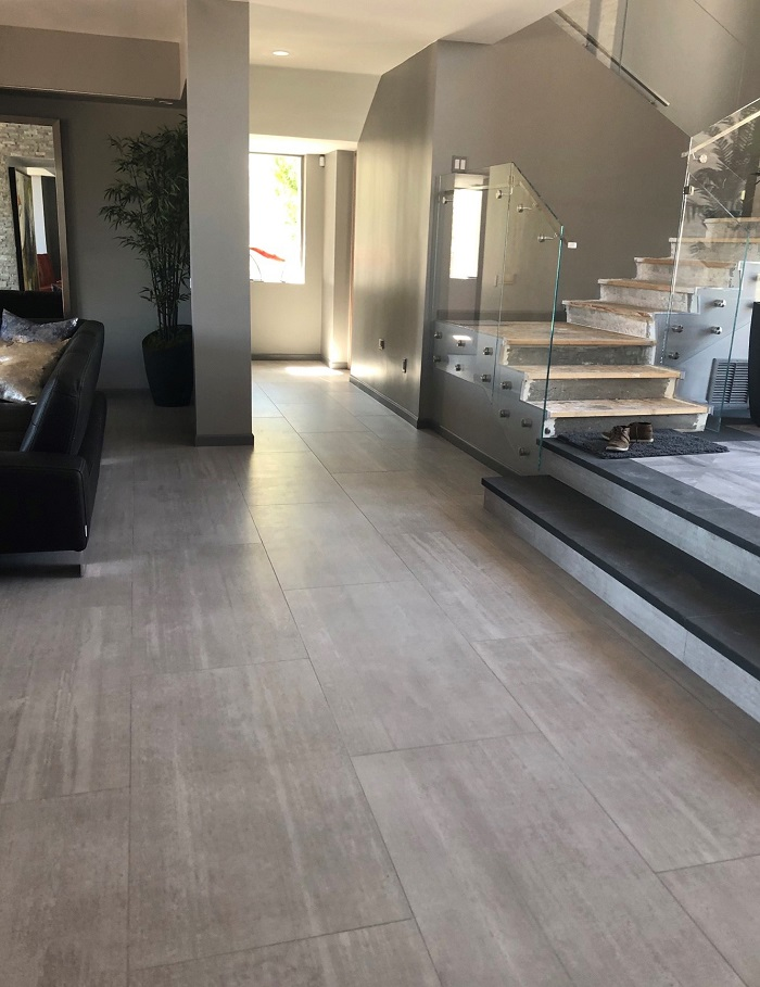 24 x 48 in ASH  - The client chose this beautiful modern porcelain tile throughout the main home. Compliments the Interior Space nicely