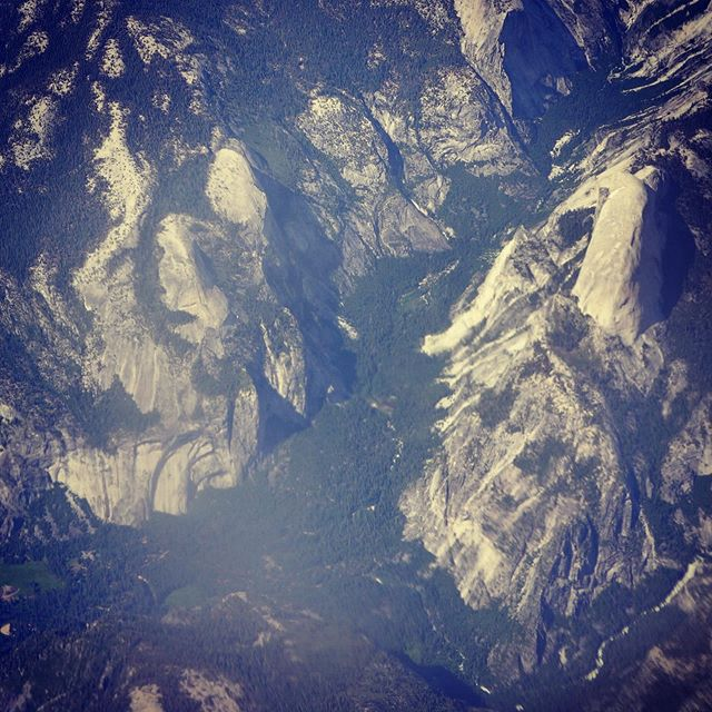 Flying back to California from visiting some of New Mexico's frontier saloons, and the pilot stokes us out by flying almost directly over Yosemite Valley at 35k feet. You can clearly see Half Dome on the far right. @travelyosemite @yosemite_national_park @yosemiteconservancy