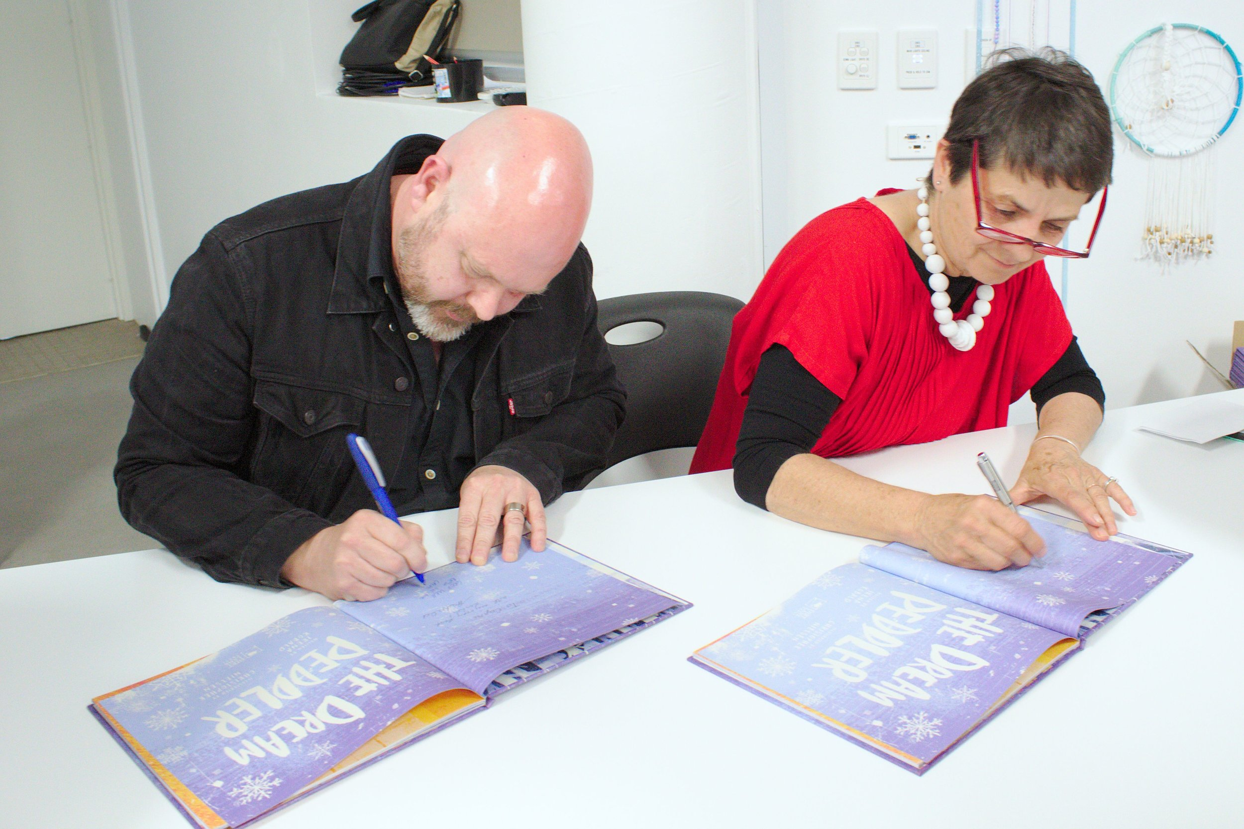 Chris and irena signing books like crazy …