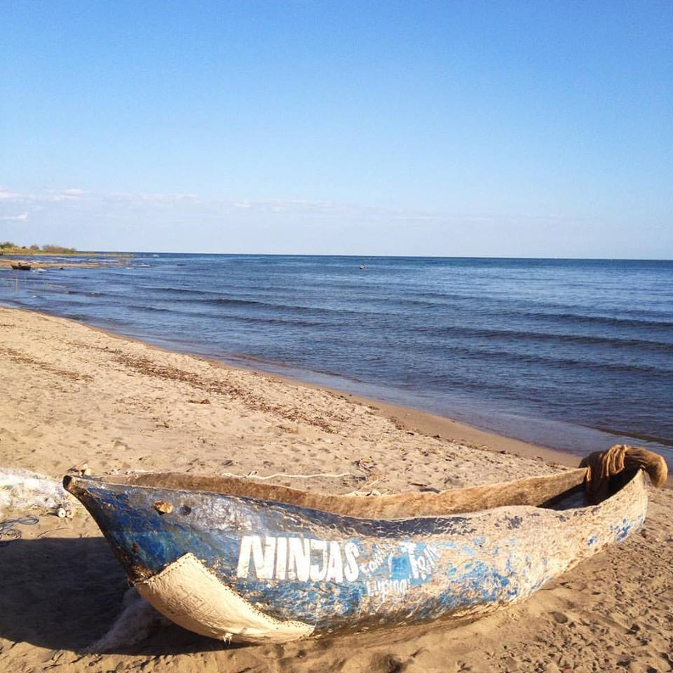 Old canoe on beach.jpg