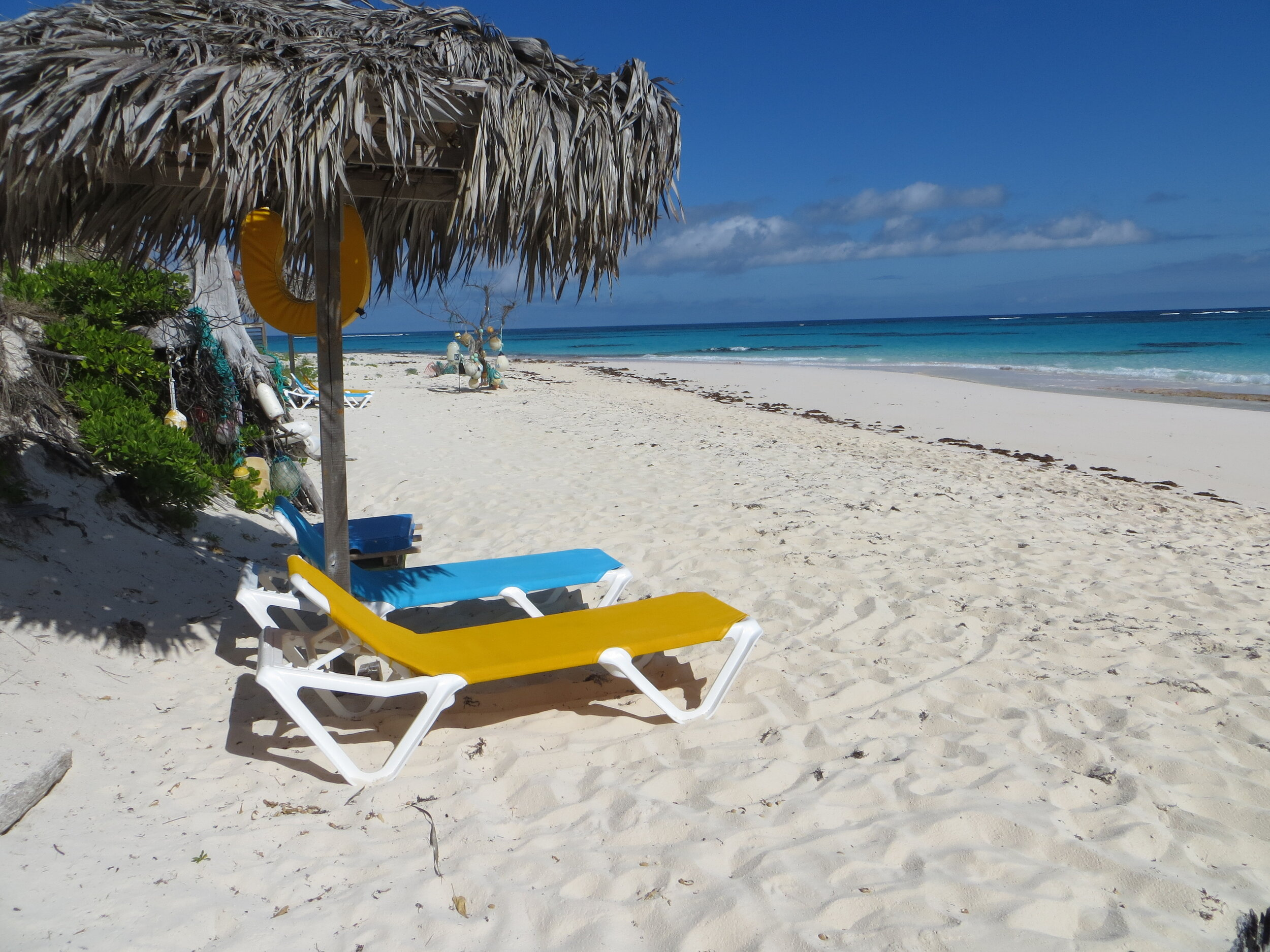 Property harvested thatch covered shaded beach pulapas! - Comfy chaise lounges!