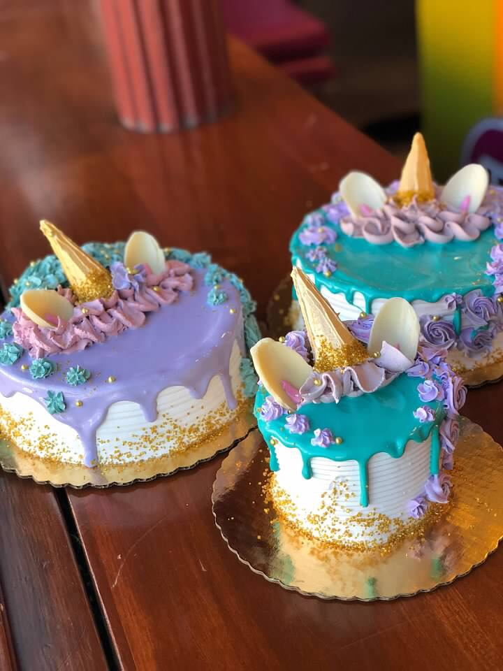 THEME CAKES - Simple, fun, and delicious; these cakes are decorated with rainbows, balloons, white chocolate bows, and dripping ice cream cones. Whatever the occasion, these cakes will surely make your guests smile.