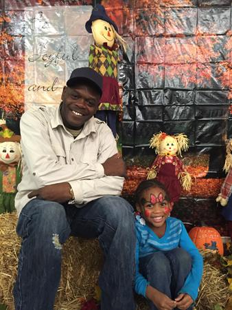 Naida  Burgos - Harvest Fest 2015 family Peter and grandaughter.jpg