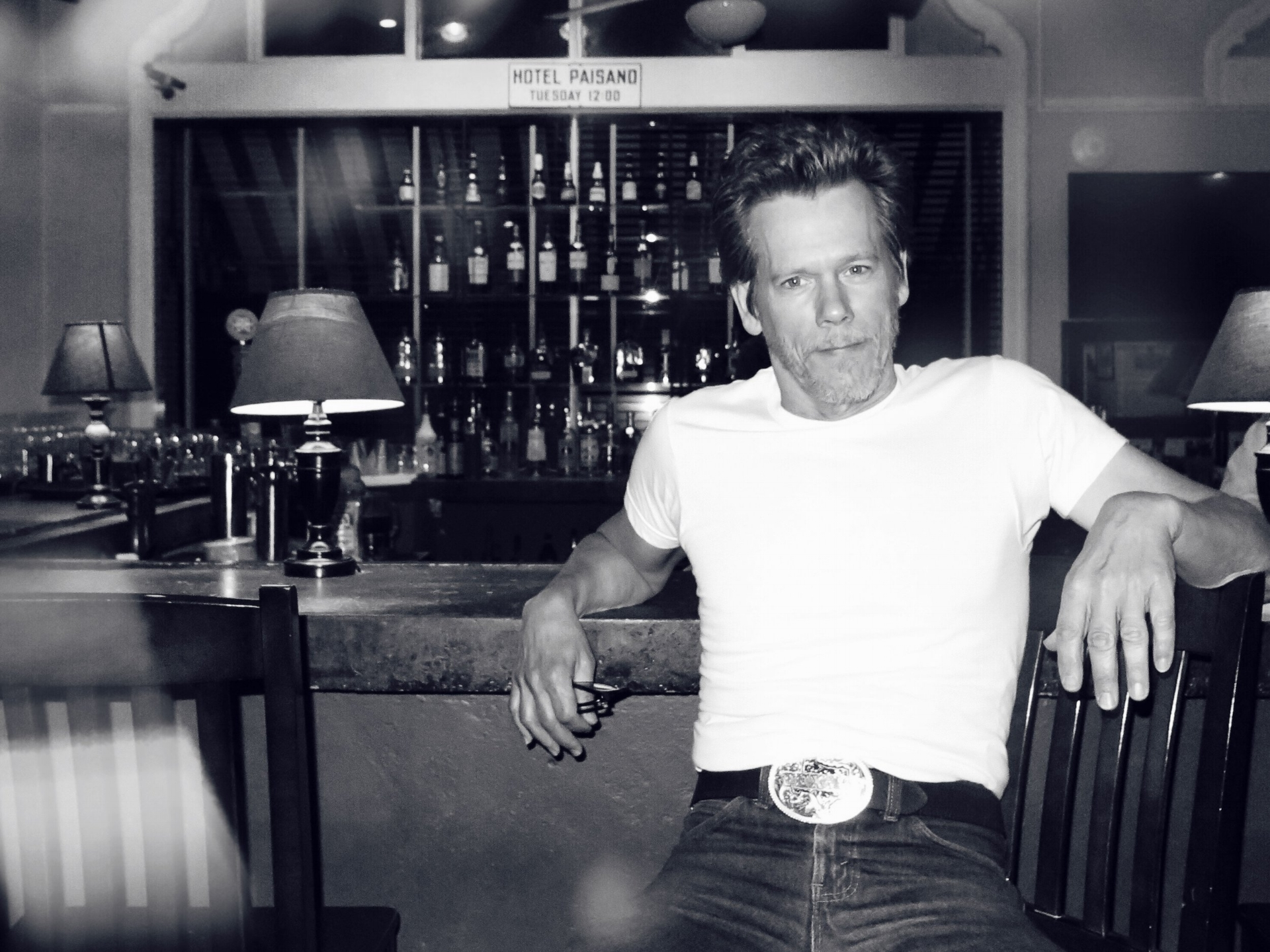 Kevin Bacon sitting at Jett's Grill before he filmed his last scene of the pilot at Hotel Paisano.