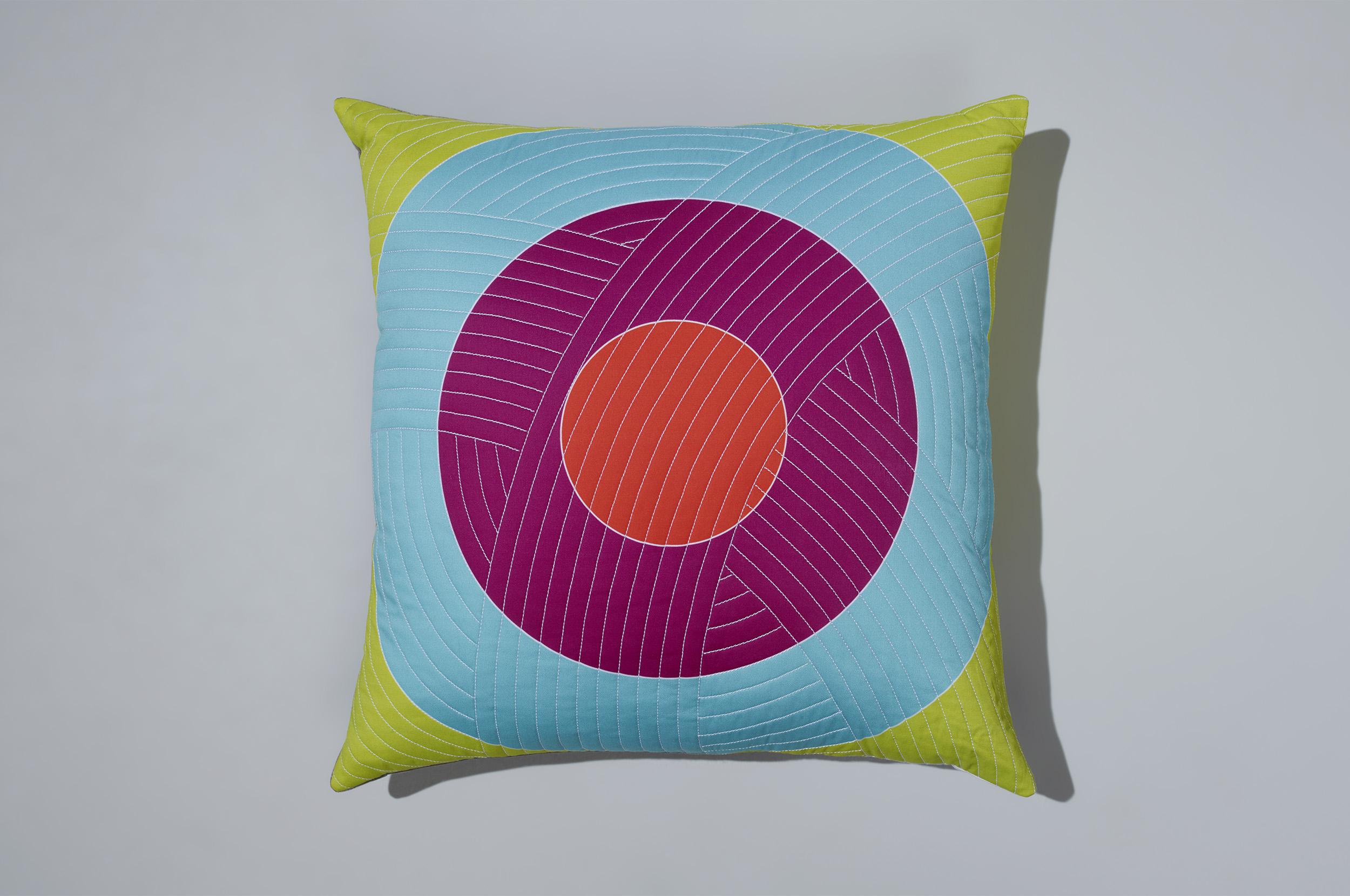 PostAndGleam_Pillows_OrangePinkBlueGreenCircle_COMP_Oa_FL2500.JPG