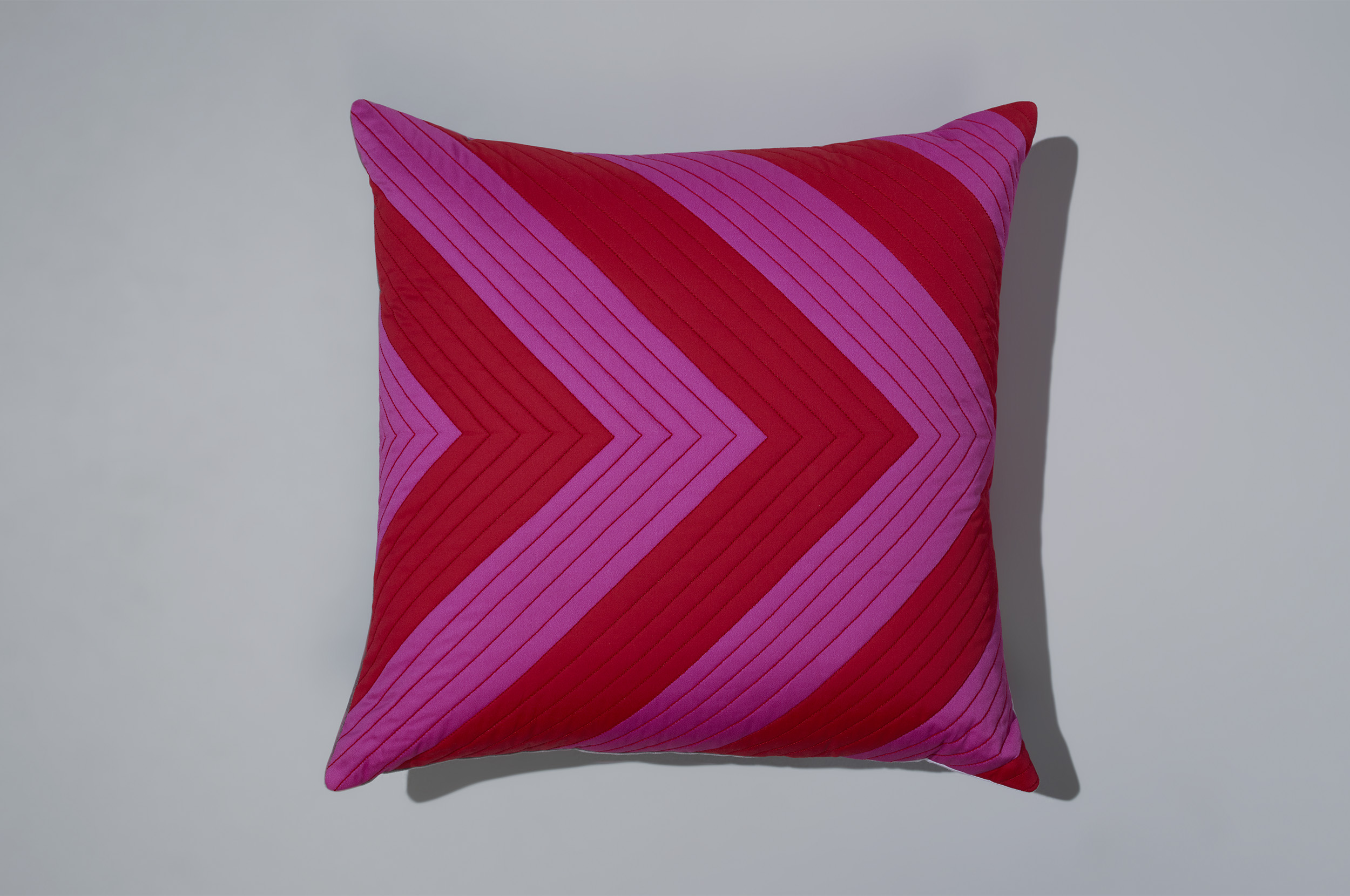 PostAndGleam_Pillows_RedPinkChevron_COMP_Oa_FL2500.JPG