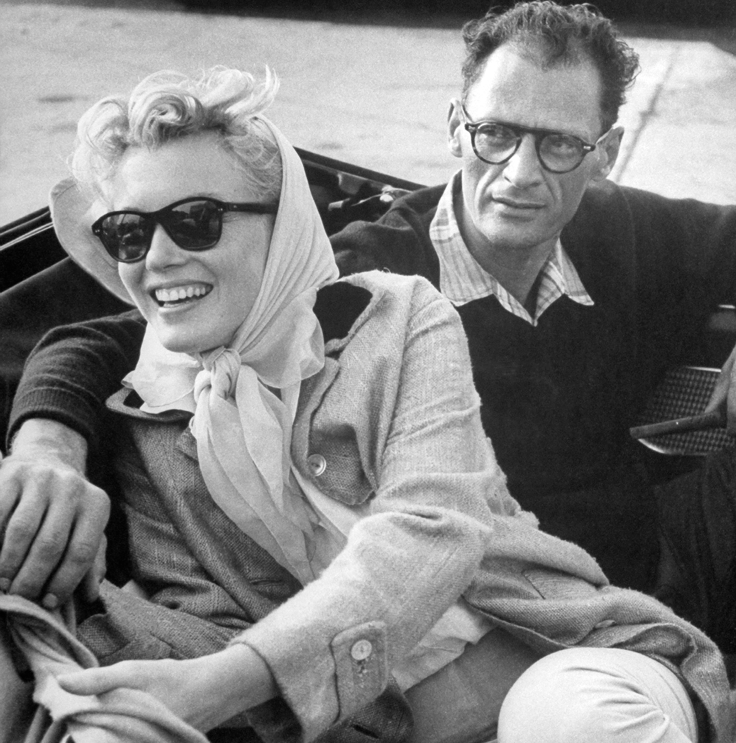 1956 Marilyn Monroe and Arthur Miller in a Thunderbird convertible on the way to Connecticut