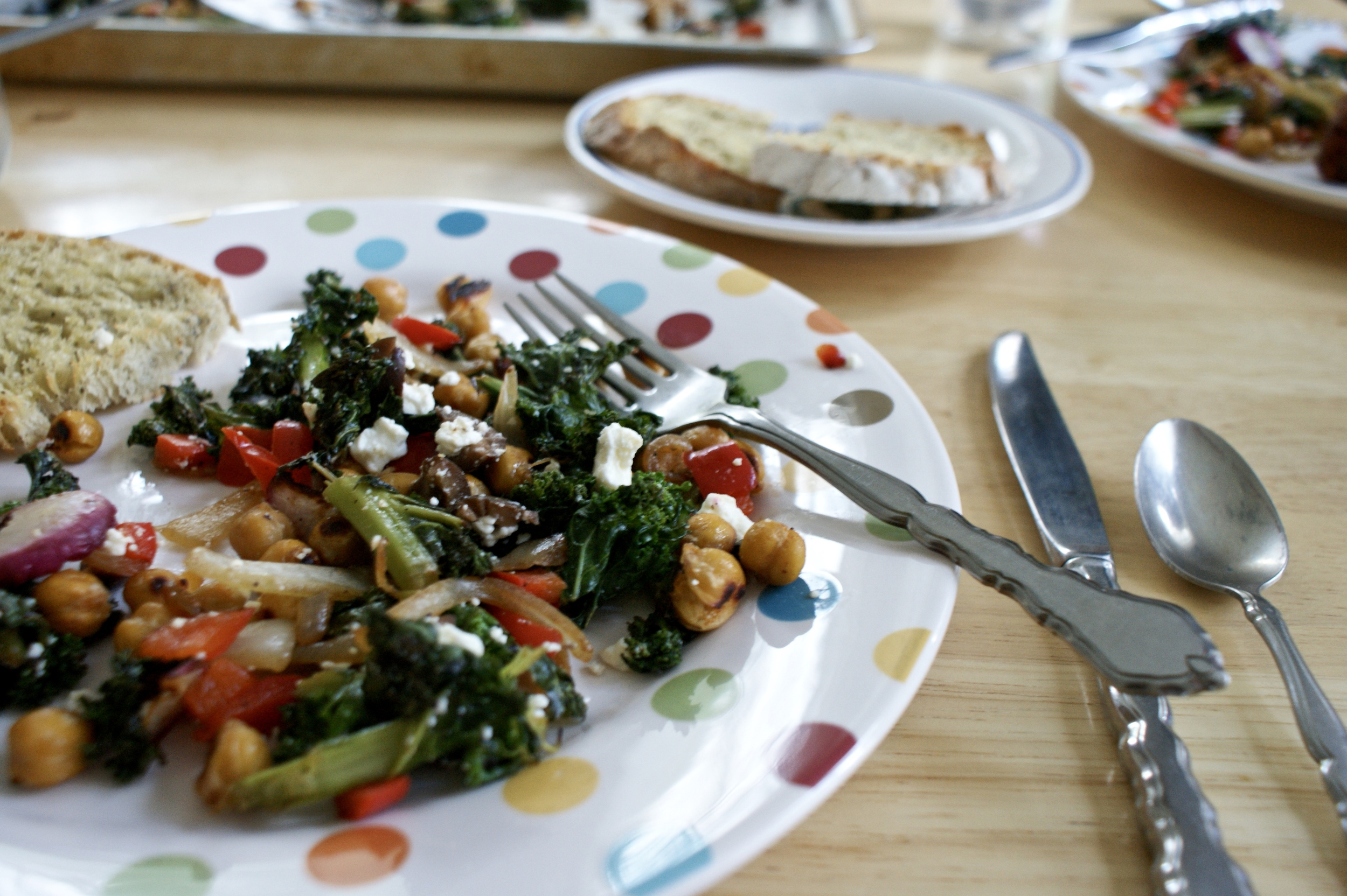 kale + vegetable sauté with crispy garbanzos, olives, + feta, served with Erin's homemade bread + olive oil.