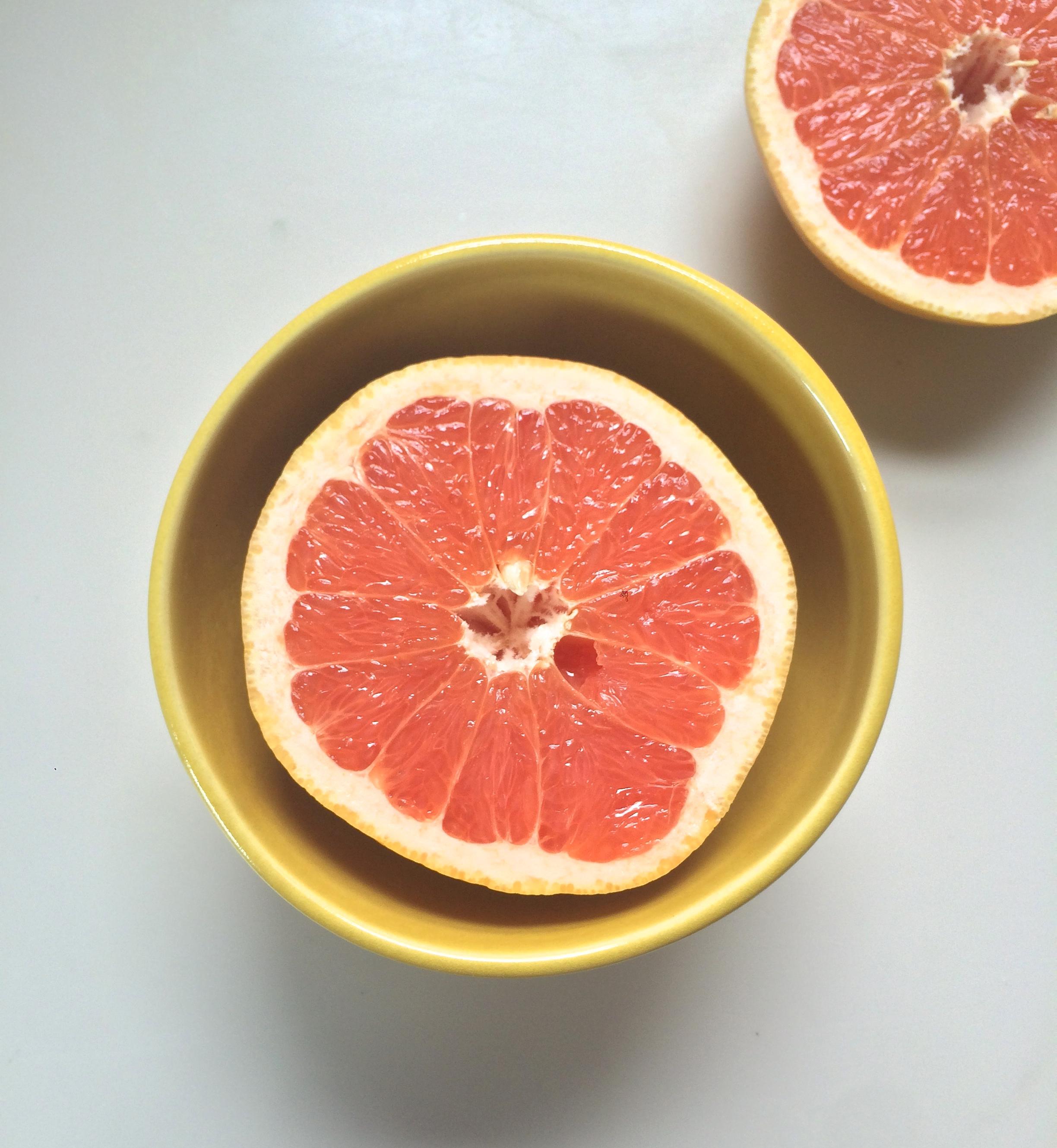 Grapefruit sliced in half. If I'm feeling like I need a bit of a sugar boost, I'll sprinkle a couple teaspoons of sugar on top.