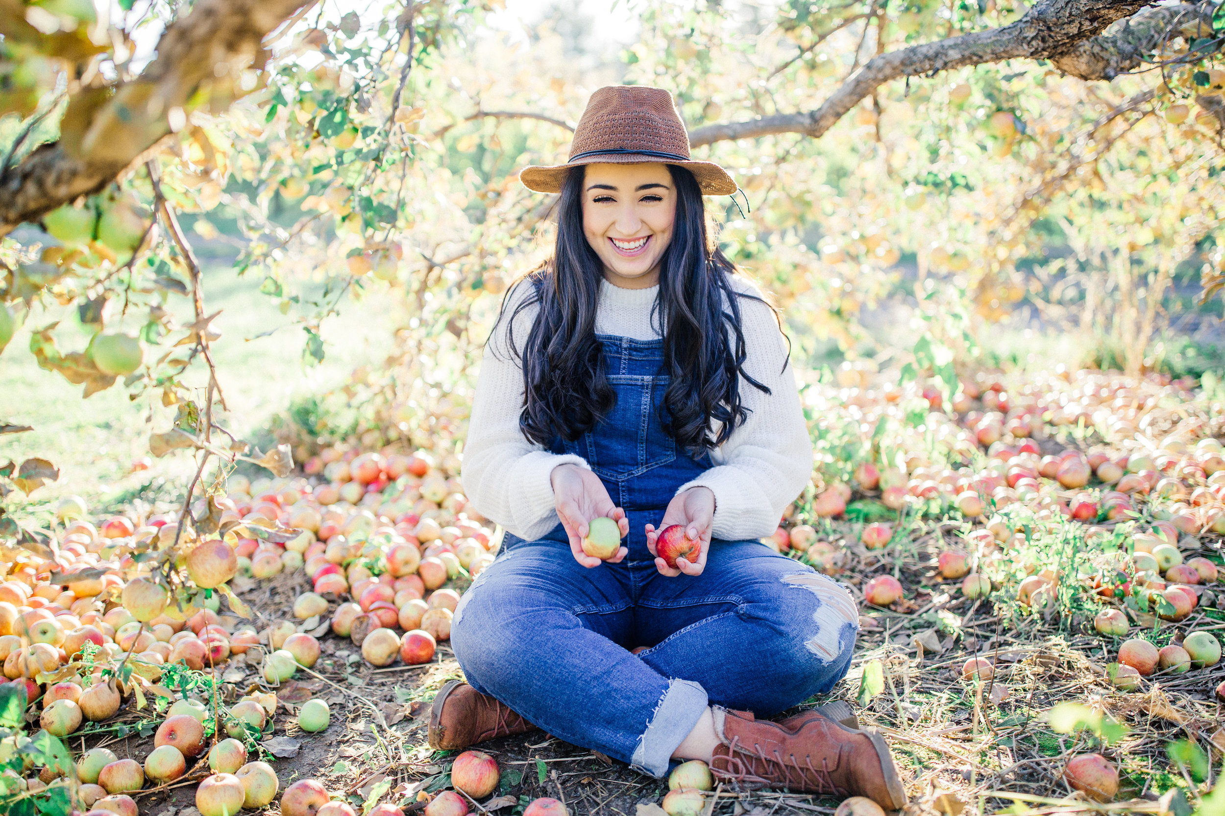 Stillwater Senior Portraits at an Apple Orchard during golden hour
