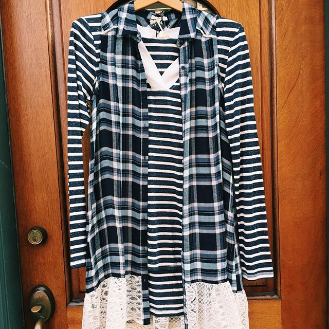All of this warm weather has us putting away our coats and reaching for spring layers! Check out this plaid tunic with lace bottom! #springcomesoon #springfashion #springlayers #hollandmi #tikalholland #puremichigan #plaids #stripes