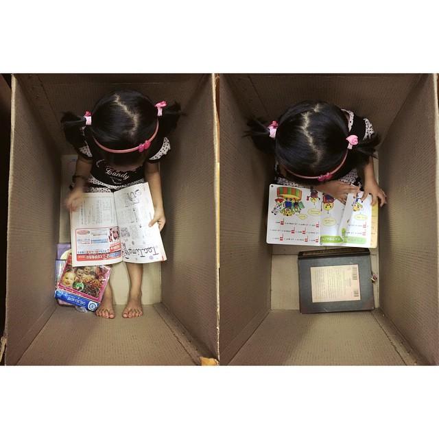 Kiki exploring her world through reading.
