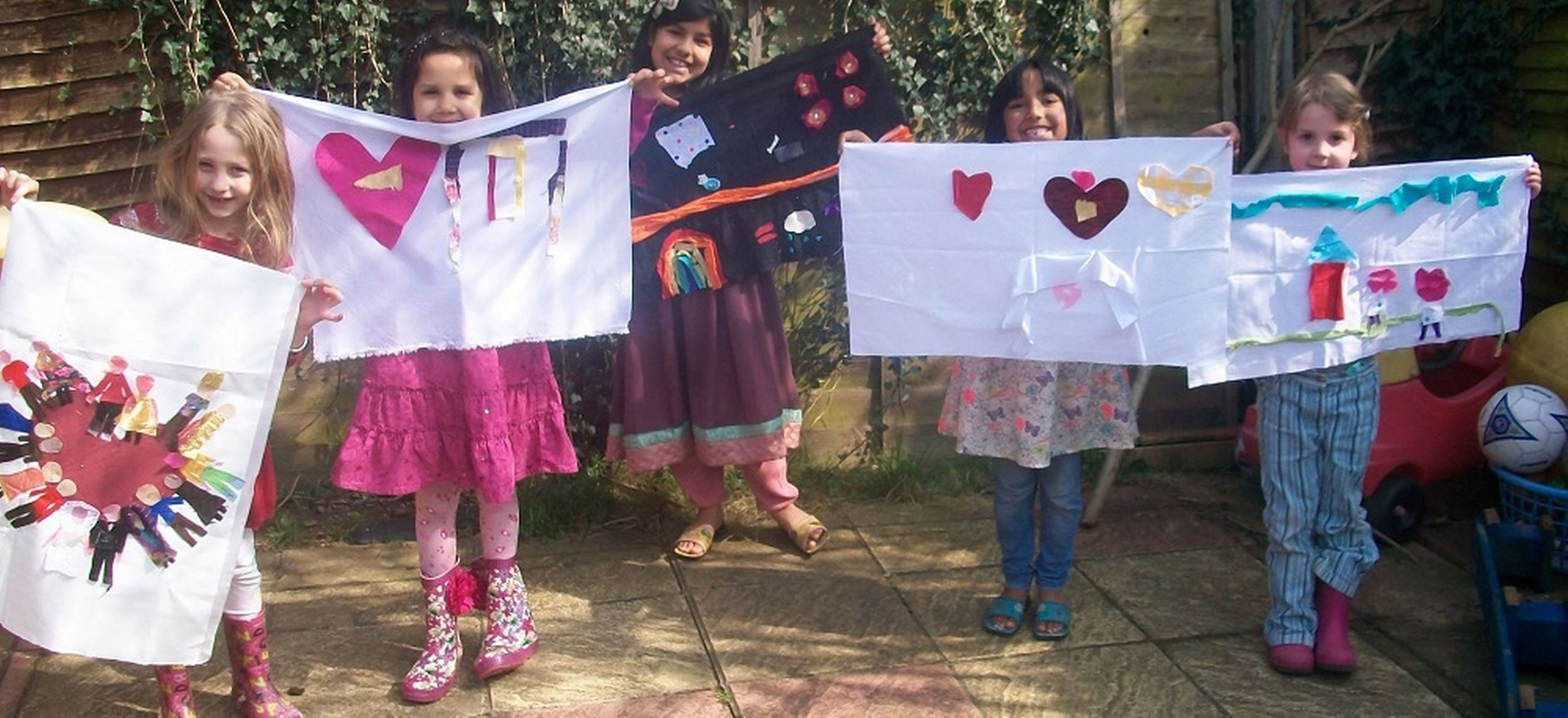 The children get ready to parade flags depicting their love for the villages
