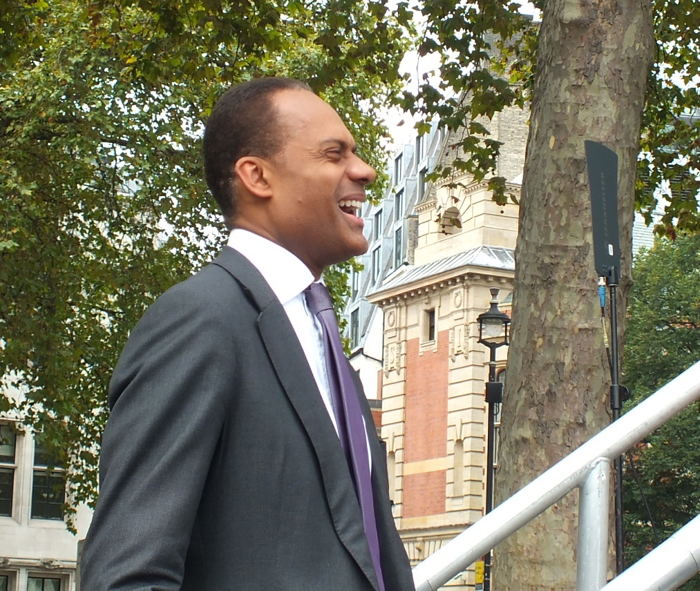 Adam Afriyie MP, Conservative MP for Windsor laughs as Gyles Brandreth gives him a big (and humorous) introduction prior to his speech.