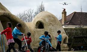 Children prefer to play OUTSIDE not in an Adobe hut