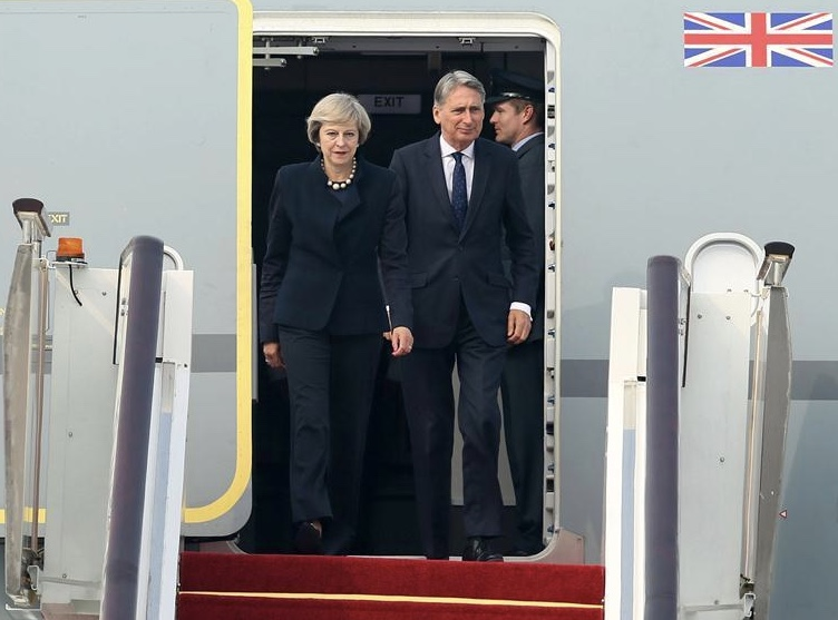 The PM arrives in China with Chancellor Philip Hammond