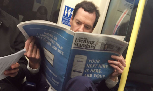 Hard to believe - He reads the paper AND travels on the Tube