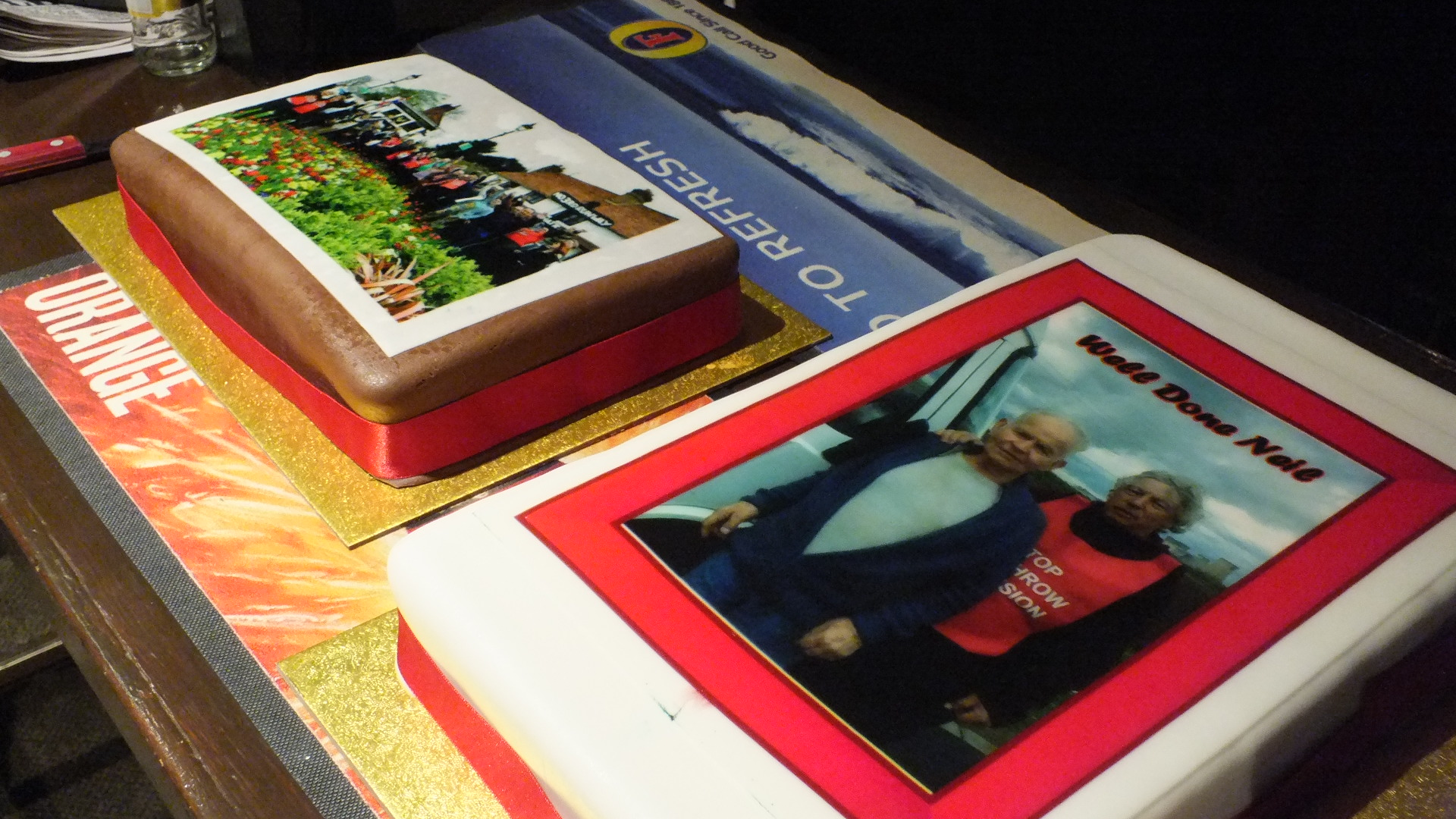 Two delicious cakes depicting the village send-off and the pair reaching Drax Power Station
