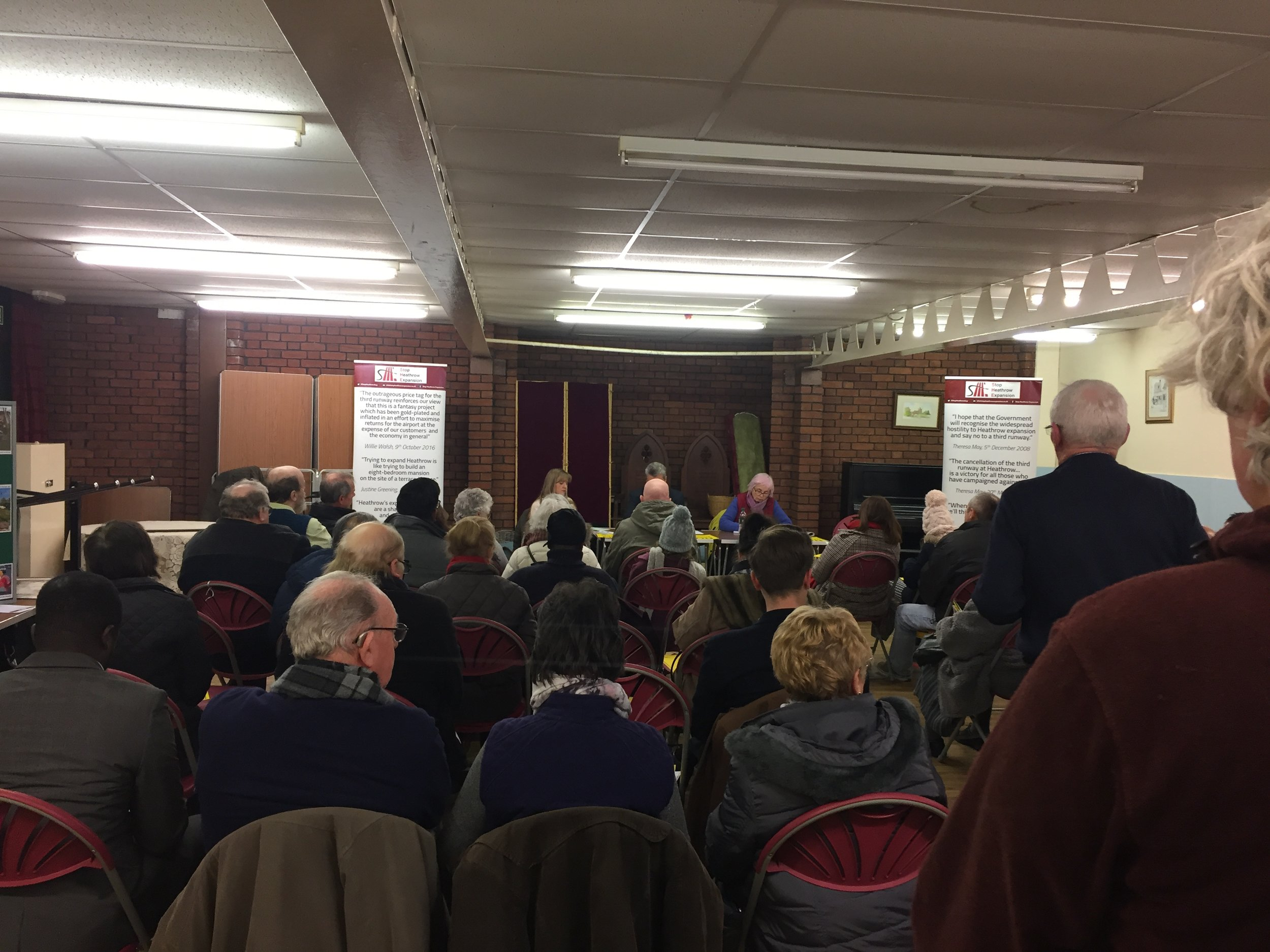 Residents in warm coats and woolly hats filled the village hall