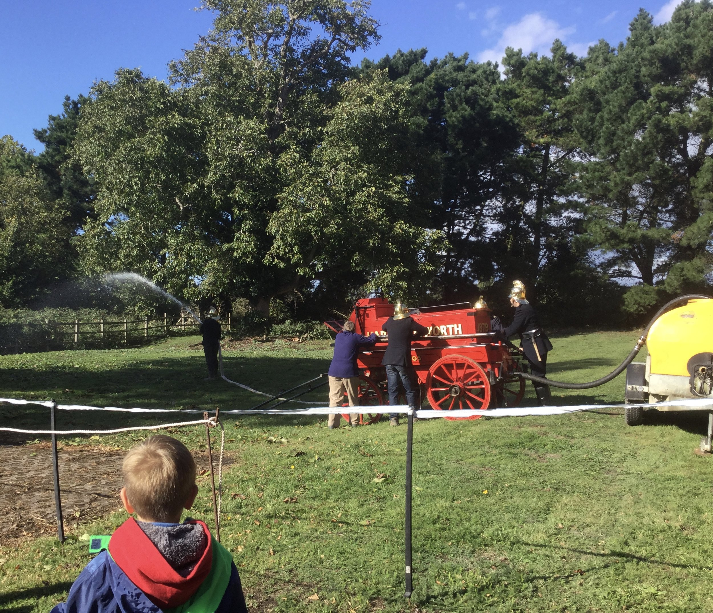 Fascinating demonstration of how the hand-pumped village fire engine worked to put out fires