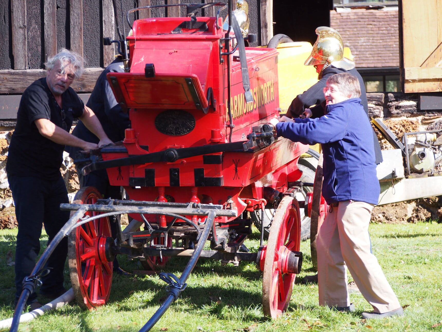 Villagers add some muscle to help demonstrate the original Harmondsworth fire engine