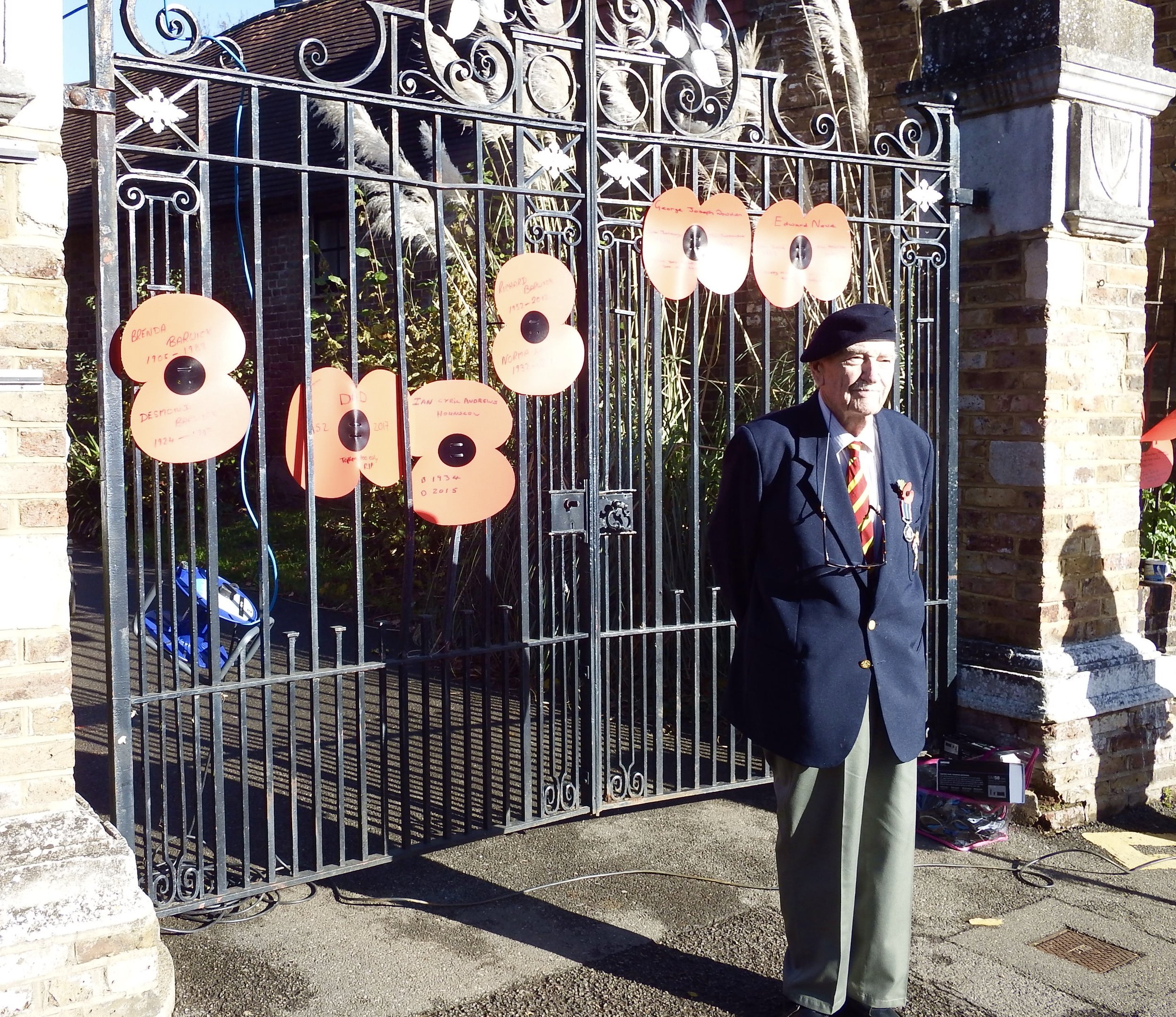 Roy Barwick outside the church gates with their poppies of remembrance