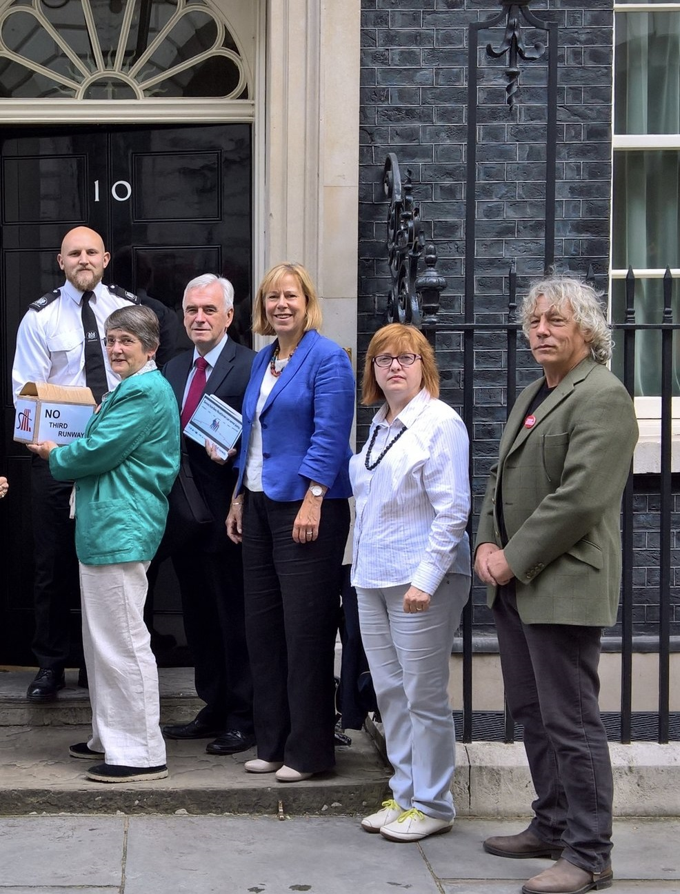 John McDonnell MP (holding cards) and Ruth Cadbury MP (blue jacket) on the steps of No 10 with campaigners and Harmondsworth residents