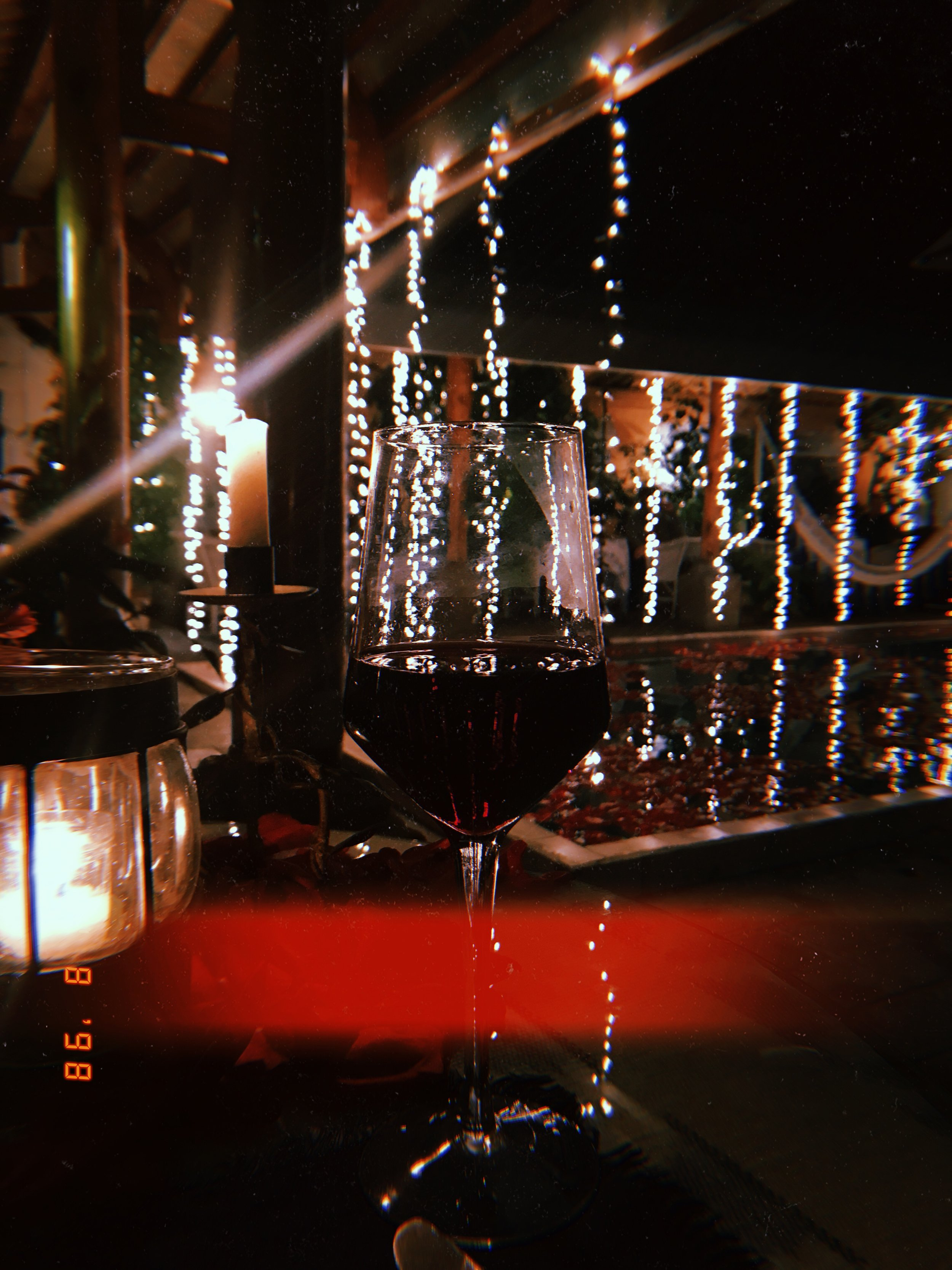 A quick glass of red next to the rose petal covered pool at Welten.