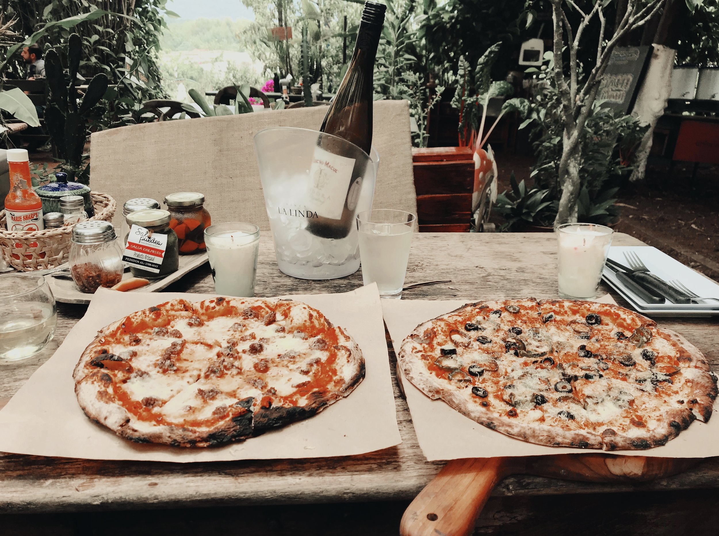 The two pizza & wine special at Caoba Farms.