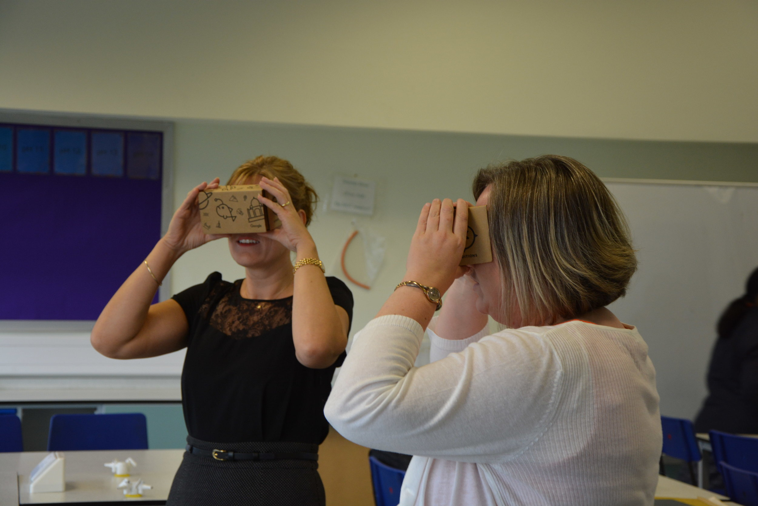 Two Science teachers looking at Google Expeditions via the Google Cardboard viewers (picture courtesy: Dr. Duncan Banks)